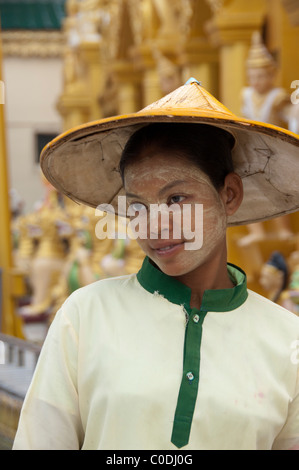 Myanmar (aka Burma), Yangon (aka Rangoon). Stupa Shewedagon, local woman with typical thanaka (natural sun cream) - Stock Photo