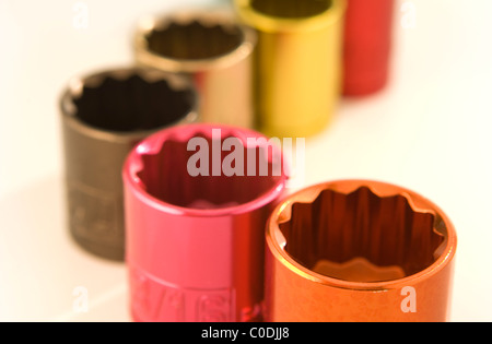 Color coded metal sockets from a socket wrench set - Stock Photo
