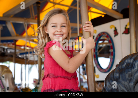 Little girl on carousel - Stock Photo