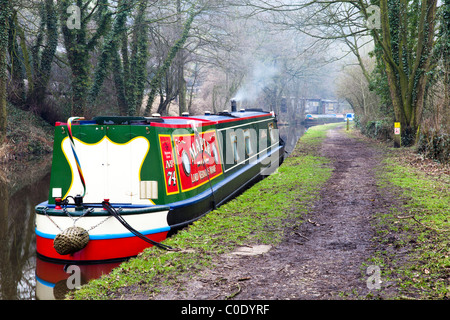 Brightly colored canal boat on the Macclesfield canal near the village of Sutton. - Stock Photo