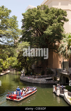 People sightseeing on a river taxi San Antonio Texas USA - Stock Photo