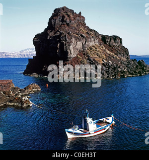 A fishing boat moored off the coast of the island of Santorini, Greek Islands, Greece - Stock Photo