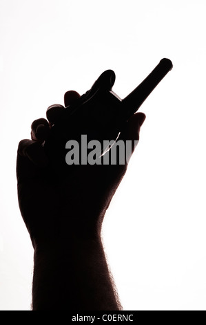 Hand holding a walkie talkie radio telephone on a white background - Stock Photo