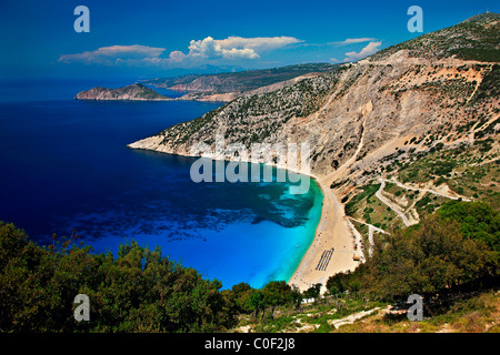 World famous Myrtos beach in Kefalonia island. In the background in that small peninsula you can see Assos village. - Stock Photo