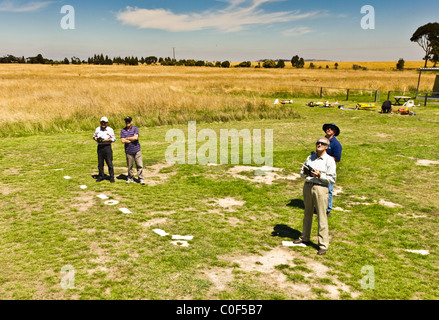 Men flying Radio Control Aircraft - Stock Photo