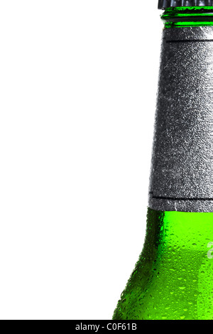 Close up photo of an ice cold bottle of beer, right of frame, white background. - Stock Photo