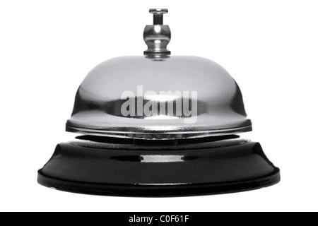 Photo of a chrome reception bell isolated on a white background. - Stock Photo