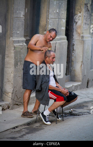 Street scene in Havann Viejo,open air hair cutter, Havanna Cuba - Stock Photo