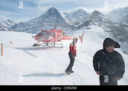 Bohag Helicopter landing in Mannlichen, Grindelwald Bernese Oberland, Switzerland - Stock Photo