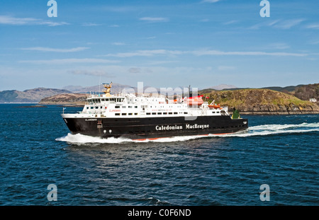 Caledonian MacBrayne car and passenger ferry Clansman leaving Oban on the west coast of Scotland for Hebredian islands - Stock Photo