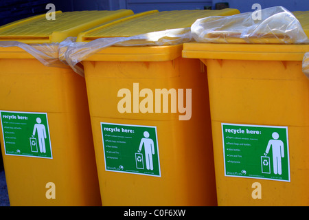 Row of yellow recycling bins at bird sanctuary. - Stock Photo