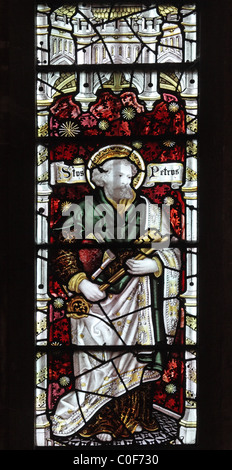 A stained glass window by C E Kempe & Co. depicting St Peter, St John Baptist Church, North Luffenham, Rutland - Stock Photo