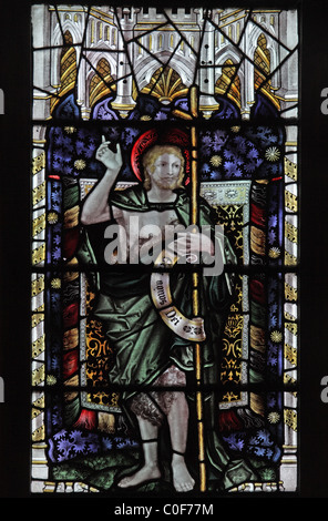 A stained glass window by C E Kempe & Co. depicting St John the Baptist, St John Baptist Church, North Luffenham, - Stock Photo