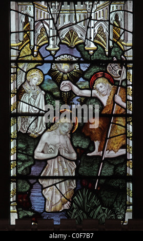 A stained glass window by C E Kempe & Co. depicting the Baptism of Jesus, St John Baptist Church, North Luffenham, - Stock Photo