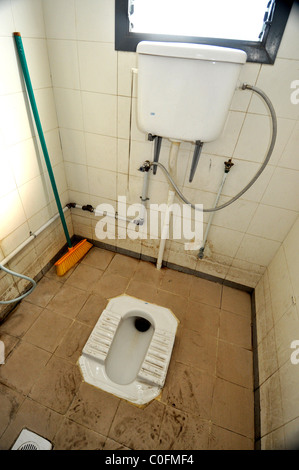 A Hole In The Ground Public Toilet In France Stock Photo