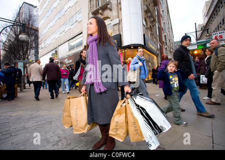 Female Shopper on Oxford Street, London, England, United Kingdom. Photo:Jeff Gilbert - Stock Photo