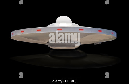 UFO saucer with white dome top. - Stock Photo