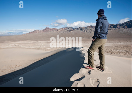 Person takes in view of desert landscape from Eureka dunes, Death Valley national park, California - Stock Photo