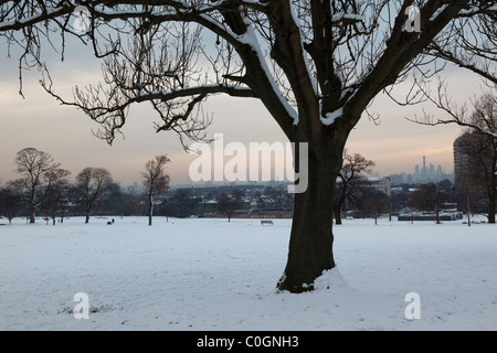 Snow covered landscape in Brockwell Park - Stock Photo