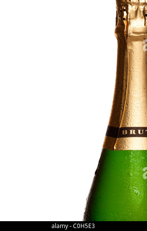 Close up photo of champagne bottle covered in water droplets, on right side of frame with white background. - Stock Photo