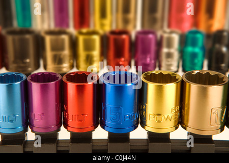 Colored coded metal sockets from a socket wrench set - Stock Photo