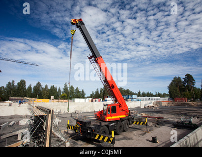 Lokomo ( MS 335 N ?? ) boom crane at construction site , Finland - Stock Photo