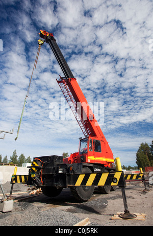 Lokomo ( MS 335 N ?? ) boom crane at construction site - Stock Photo