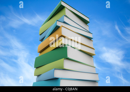 Books stacked blue sky background - Stock Photo