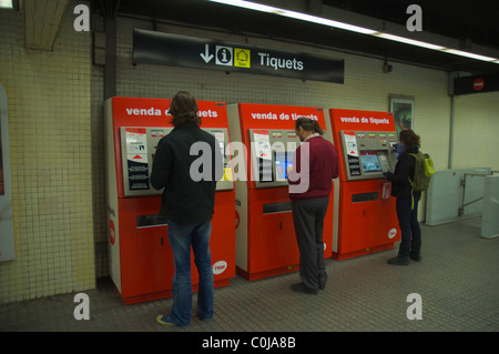 People buying tickets at Jaume I metro station central Barcelona Catalunya Spain Europe Stock Photo