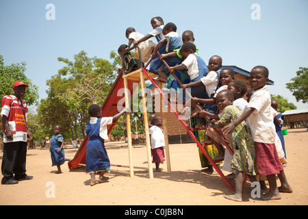Children play at a centre for orphans and vulnerable children funded by UNICEF in Mchinzi, Malawi, Southern Africa. - Stock Photo