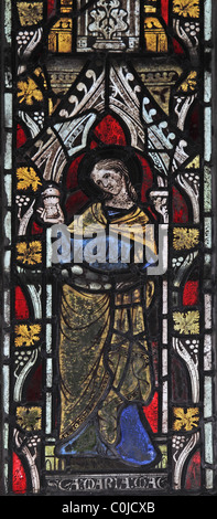 A 14th century stained glass window depicting St Mary Magdelene, St John Baptist Church, North Luffenham, Rutland - Stock Photo