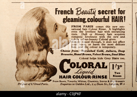 Advertisement from a 1950 magazine for Coloral a liquid hair rinse coating one and three pence imperial money. EDITORIAL - Stock Photo