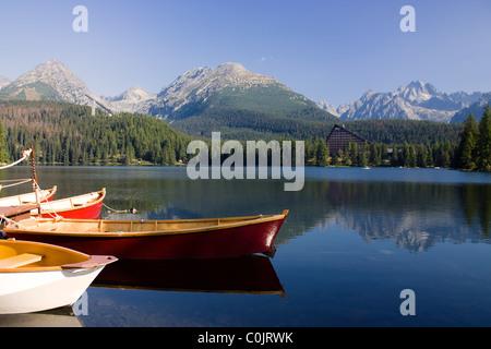 Mountain lake with boats in National Park High Tatra, Slovakia - Stock Photo