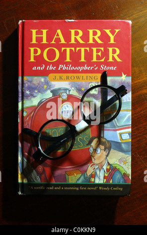 rare first edition of JK Rowling's Harry Potter and the Philosopher's Stone. - Stock Photo