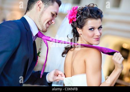Young wedding couple indoors funny portrait. - Stock Photo