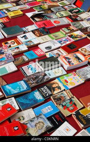 Secondhand books on market stall in Spain - Stock Photo