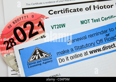 UK, Britain. DVLA renewal reminder form for renewing road tax disc with motor insurance certificate and MOT test - Stock Photo