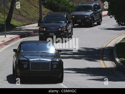 David Beckham leaving his home in his black drop top Rolls Royce