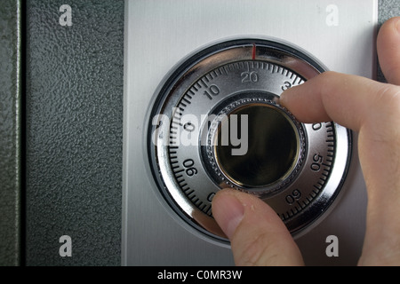 Hand Turning Combination Lock on Safe - Stock Photo