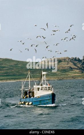 A motor fishing vessel returns to port at Howth near Dublin Republic of Ireland Europe - Stock Photo