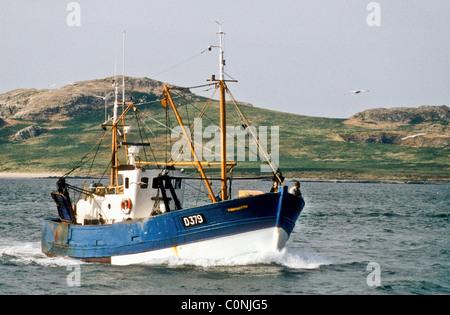 A motor fishing vessel returns to port at Howth near Dublin Republic of Ireland - Stock Photo