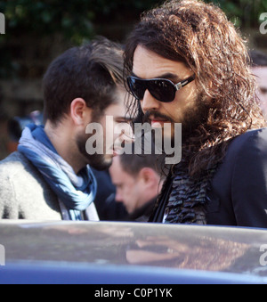 Comedian Russell Brand was not in the mood for joking as he left his house this morning after being suspended from - Stock Photo
