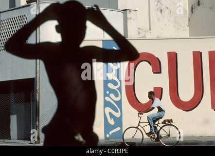 Havana Cuba Young boy poses against background of Viva Cuba Libre painting in old Havana - Stock Photo