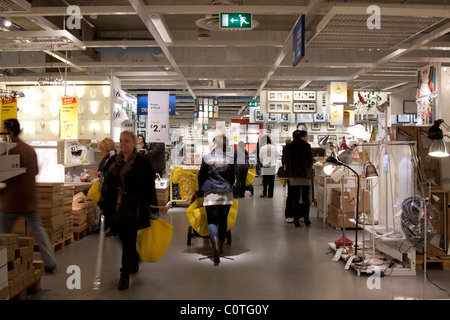 ikea store interior people shopping and waiting at the. Black Bedroom Furniture Sets. Home Design Ideas