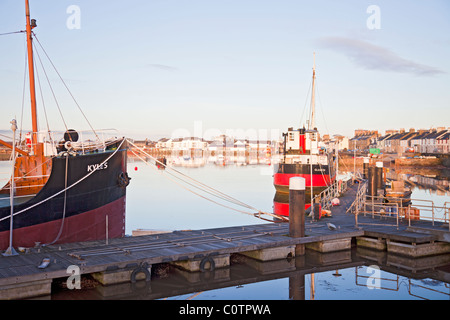 Irvine Harbour , North Ayrshire, in winter showing MV Kyles and MV Spartan moored to a pontoon jetty. - Stock Photo