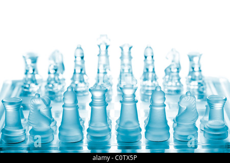 Glass chess on chessboard - Stock Photo