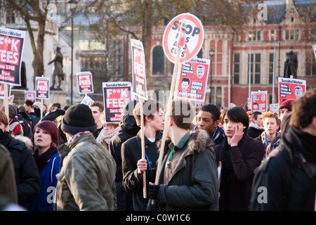 Students demonstration against tuition fees cut in Parliament Square, London on 9 December 2010 - Stock Photo