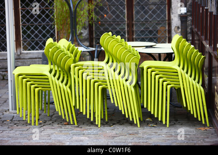 Stacked chairs in front of a bar, cafe, restaurant. Waiting for clients. - Stock Photo