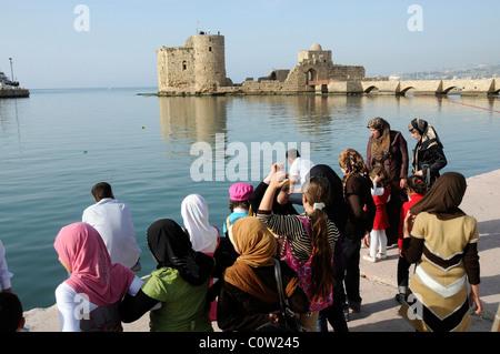 MUSLIM FAMILIES AT THE  HARBOUR AT SAIDA, (SIDON) IN  LEBANON - Stock Photo