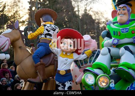 Disney character parade down Main Street at Disneyland Paris in France - Stock Photo